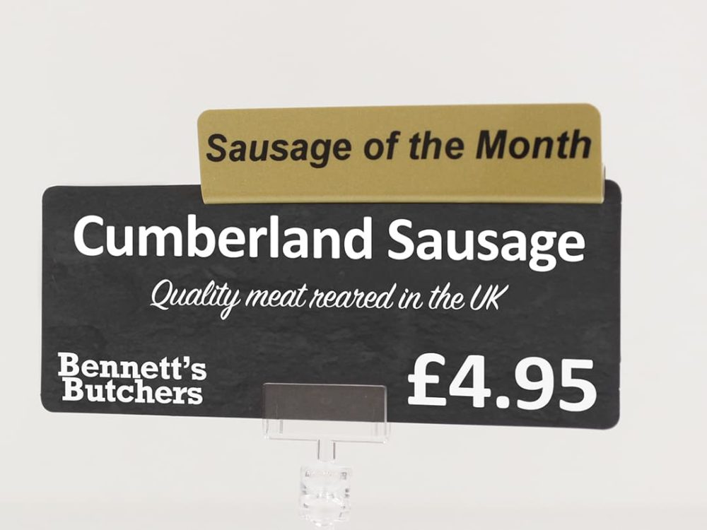 Sausage of the Month Gold Topper on a Price Sign