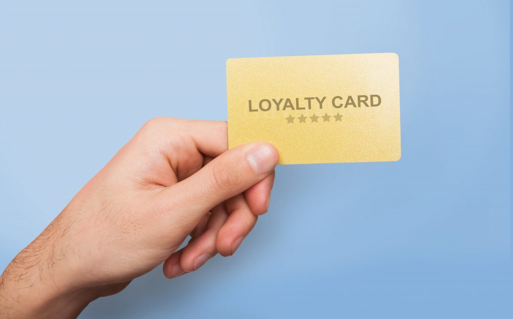 someone holding a loyalty card