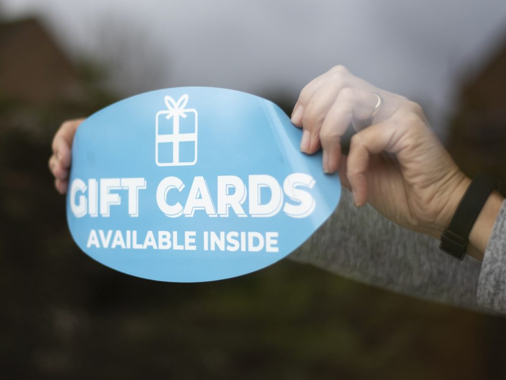 Applying a blue gift window sticker