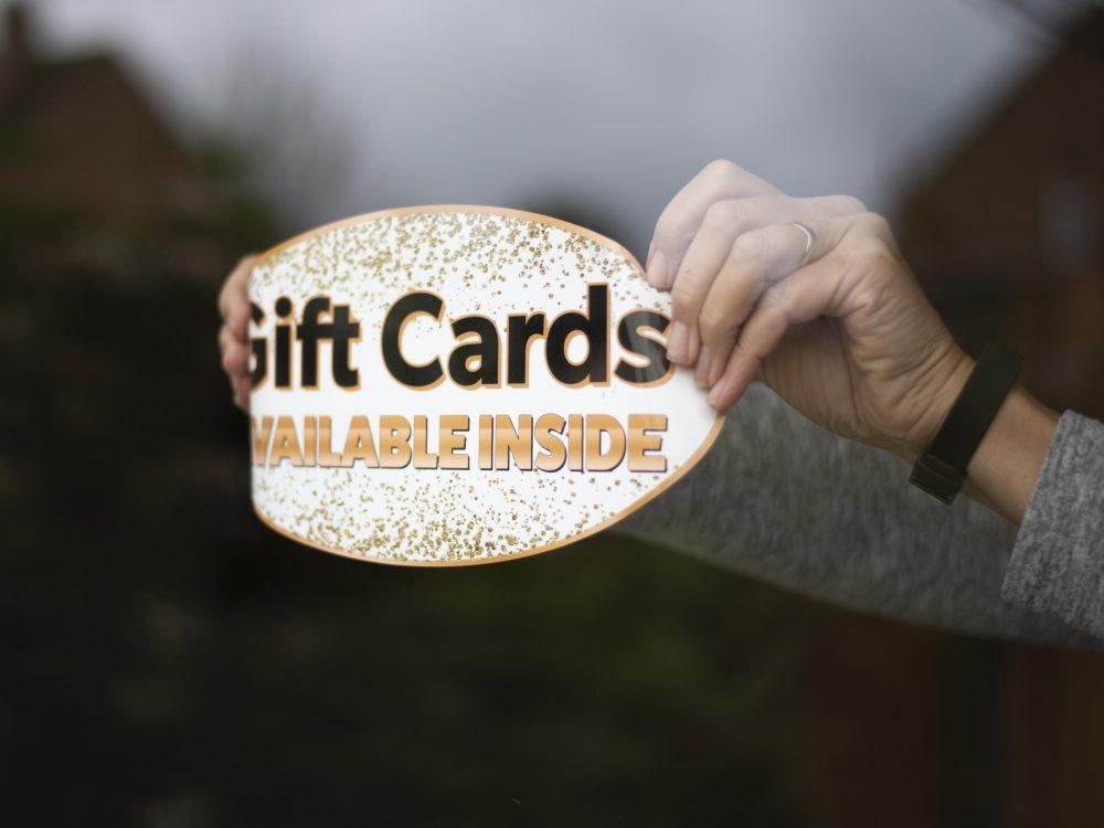 Applying a gold gift window sticker