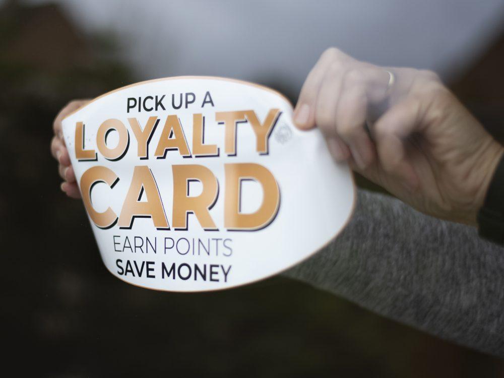 Applying a gold loyalty window sticker